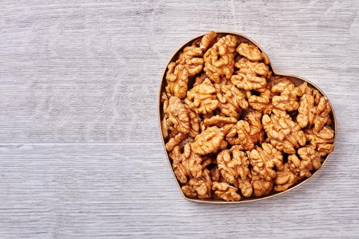 Regular consumption of foods rich in omega-3s, including walnuts and fish, can reduce risk of death three years after suffering a heart attack